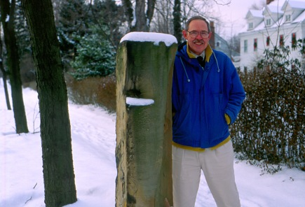 Don Janzen standing at the Shaker gatepost in the snow in Cuyahoga County, OH, January 30, 1994. Source: Donald E. Janzen Collection (CS 662, 015sc-0012)