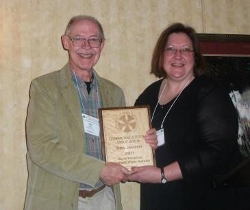 Don Janzen receives the 2011 project award for the outstanding collection of communal site photographs he developed for the Center for Communal Studies at the University of Southern Indiana, 2011. Source: Communal Studies Association Facebook Page.