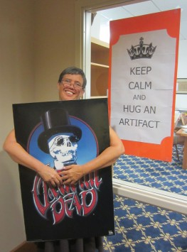 """University Archivist, Jennifer Greene, """"hugging"""" a Grateful Dead poster for National Archives Month, 2015. Source: James Wethington"""