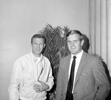 Sonny Brown and Bob Griese. Brown was a photographer for the Evansville Courier. Griese is an Evansville native who went on to be an All-American at Purdue University and quarterback for the Miami Dolphins. He was named Evansville Sportsman of the Year at the Evansville Sports Award banquet May 13, 1968; this photograph might be related to that event, 1968. Source: Sonny Brown collection, MSS 228-0662.