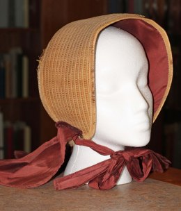 Shaker bonnet replica, 1800's. This bonnet is located in the Communal Studies Reading Room in RL 3024.