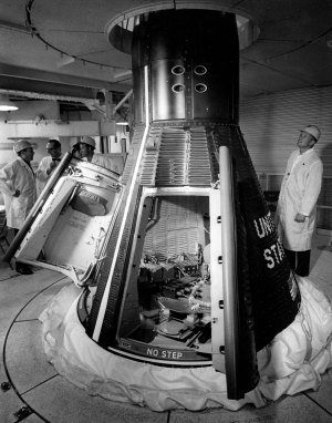 "Astronauts are briefed on the first Gemini Spacecraft by Guenter Wendt, Design Engineer for McDonnell Aircraft Corp., in the Whiteroom at Launch Complex 19, Cape Kennedy, Fla."" From left; Gus Grissom, Guenter Wendt, L. Gordon Cooper, Neil Armstrong."