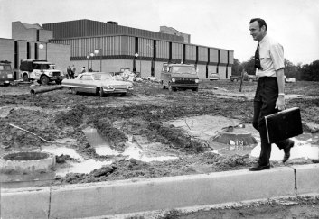 Dr. David L. Rice walking in front of the construction of the Science Center, 1969. Source: University Archives and Special Collections, UP 00484.