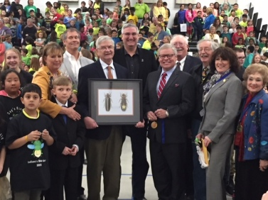 Governor Eric Holcomb (center) at Cumberland Elementary School in West Lafayette, Indiana to present Indiana's state insect, 2018.