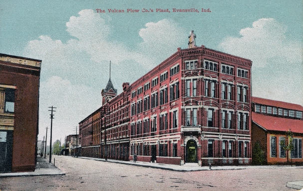 """The Vulcan Plow Co.'s plant, Evansville, Ind."" at 101 1st St., formerly 101-27 Lower 1st St. The City Foundry was formed by William Heilman and his brother in-law, Christian Katz, in 1847, with the name changed to Vulcan Plow Works after the death of Heilman in 1890. This building was razed in 1957 with only a small portion in the rear remaining. The statue of Vulcan seen atop the front corner is now housed at the Evansville Museum."", n.d. Source: University Archives and Special Collections (RH 033-034)"