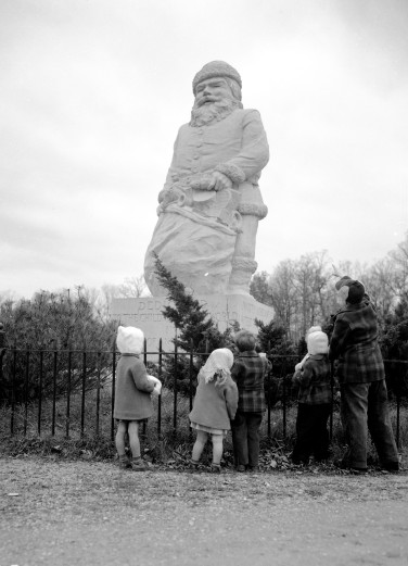 Children standing around Santa Claus statue, 1940. Source: Thomas Mueller collection, MSS 264.2174.
