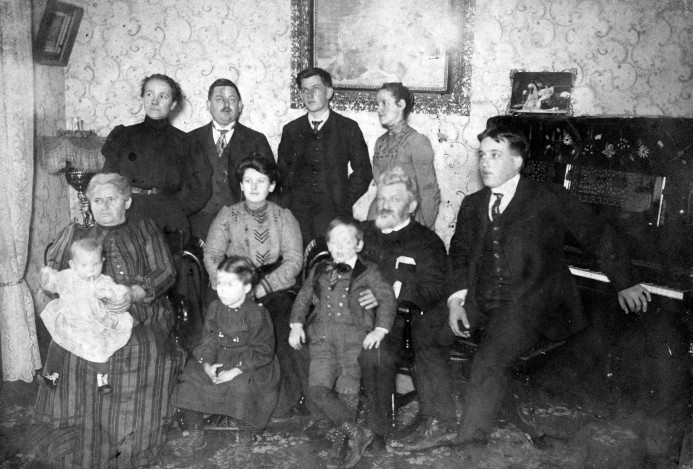 Cluthe family in their living room in Tell City. Standing in back, from left: Hulda Illing Cluthe, Dr. Charles F. Cluthe, Edward C. Cluthe, Laura Rahm Cluthe. Sitting, from left: Grandmother Cluthe holding Helen, Anna Helena Cluthe with Oramay Cluthe in front, Grandfather Cluthe holding William August Cluthe, Walter J. Cluthe. Grandfather Cluthe would be Dr. William Cluthe and Grandmother would be Lena Cluthe. Source: Oramay Cluthe-Eades collection, MSS 091-043.