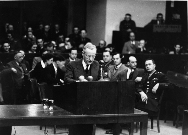 U.S. Deputy Chief of Counsel Charles M. LaFollette at the podium during the Justice Case. Behind him is the prosecution team., n.d. Source: https://collections.ushmm.org/search/catalog/pa1058535
