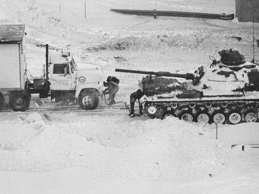 Semi-truck being pulled by a tank, 1978. Source: https://www.indystar.com/story/news/history/retroindy/2016/01/25/retroindy-blizzard-1978/79293570/
