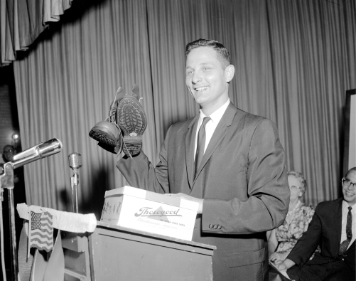 Birch Bayh receiving a new pair of boots in Mt. Vernon, IN, 1963. Source: John Doane collection (MSS 022-1879).