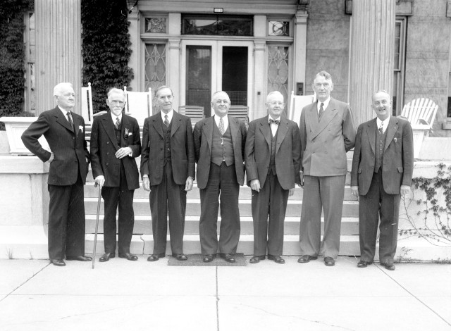 Evansville Mayors: Charles G. Covert (1901-1906), John W. Boehne, Sr. (1906-1909), William H. Elmendorf (1922-1926), Herbert Males (1926-1930), Frank W. Griese (1930-1935), William H. Dress (1935-1943, 1948-1949), and Manson Reichert (1943-1948). They are probably posing in front of Boehne's home at 1119 Lincoln Avenue, 1946. Source: Thomas Mueller collection, MSS 264-2490.