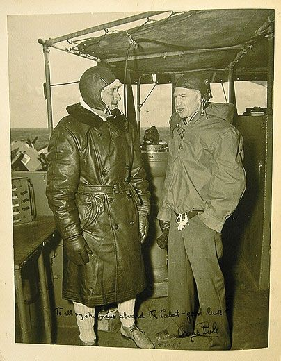 "On the USS Cabot (with Captain Walton Smith): Pyle called carriers ""ferocious."" (National Museum of Naval Aviation). Source: https://www.airspacemag.com/history-of-flight/byline-ernie-pyle-76396157/"