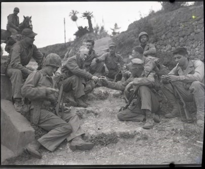 Pyle with a Marine patrol on the roadside in Okinawa, April 8, 1945. Source: https://bit.ly/2QTEFbR