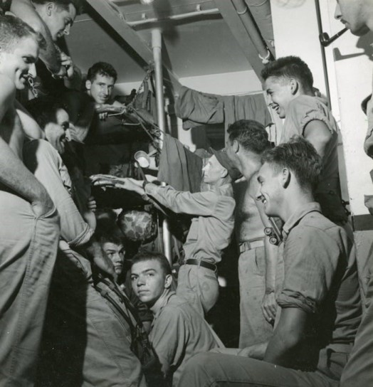 Pyle visiting Marines aboard USS Charles Carroll en route to Okinawa, March 20, 1945. Source: https://bit.ly/2QTEFbR