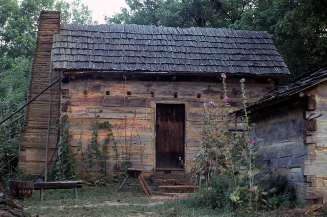 "This cabin is at the Lincoln Boyhood National Memorial in Spencer County, IN. The Memorial contains a ""Living Farm,"" which contains no original structures from Lincoln's time there, but rather is an attempt to depict what life would have been like on an 1820's Indiana farm.  Source: MSS 124-862, Eric Braysmith collection."