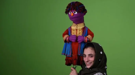 "Afghan puppeteer Seema Sultani holds a muppet named ""Zari"" for a recording of the Afghan show Baghch-e-Simsim, or Sesame Garden. Credit: WAKIL KOHSAR/AFP/Getty Images"