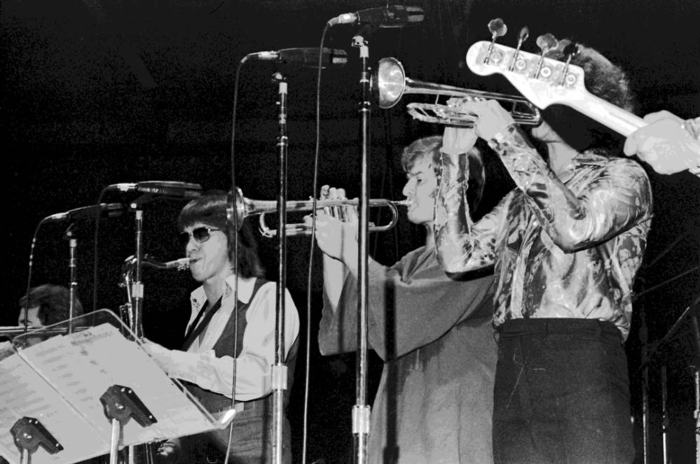 Close-up of brass and woodwind players in the band Chicago, 1976.
