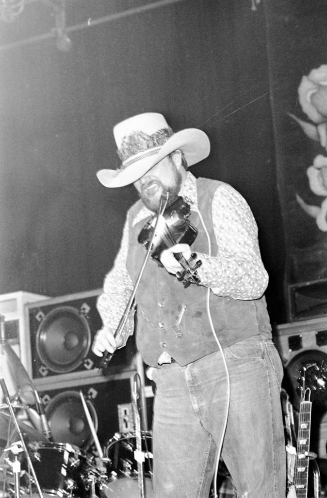 Charlie Daniels playing the fiddle at the Soldiers and Sailors Memorial Coliseum, 1977.