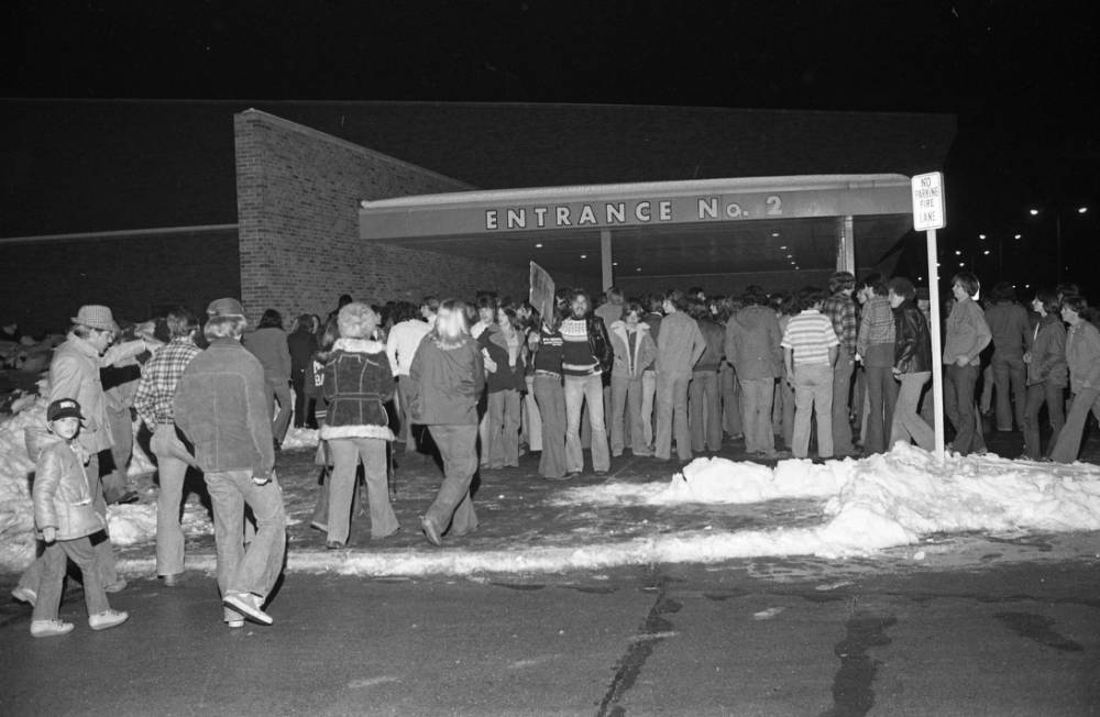 People standing in line for the Kiss Concert at Roberts Stadium, 1978.