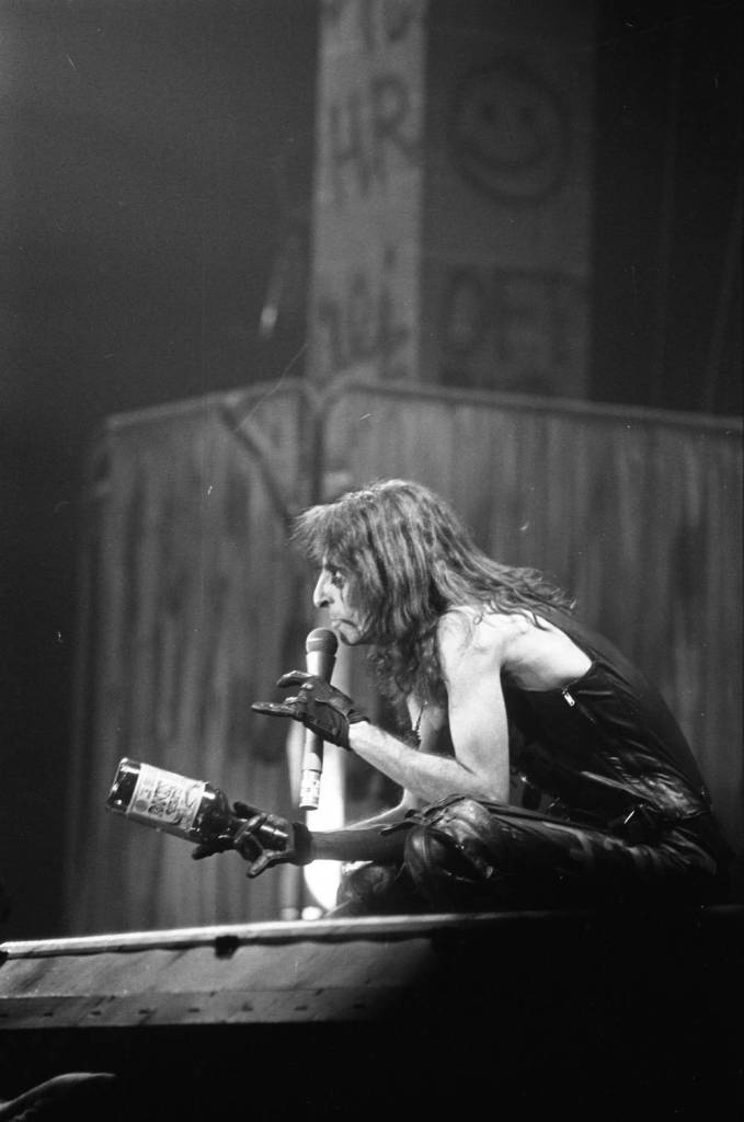 Alice Cooper on stage during his concert, 1979.