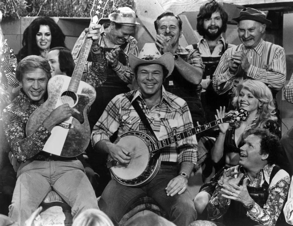 Buck Owens, Roy Clark, and other cast members, including Grandpa Jones, 1980